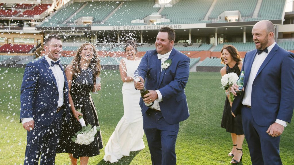 Popping bubbly at Adelaide Oval wedding