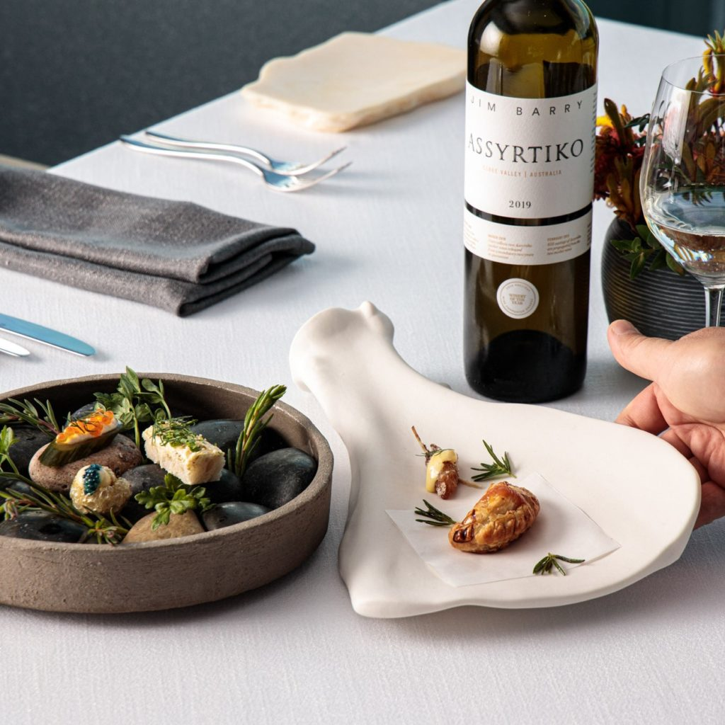 decadent food on a table with a bottle of jim barry wine